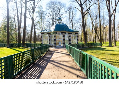 Petergof, Russia - May 05, 2016: Volary pavilion in The Lower Gardens with green fencing in spring sunny day