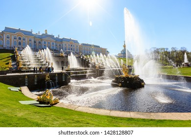 Petergof, Russia - May 05, 2016: view of The Grand Cascade, the largest fountain ensemble in Peterhof, crowd of tourists, sunny spring day