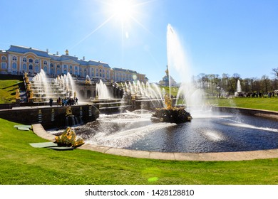 Petergof, Russia - May 05, 2016: view of The Grand Cascade, the largest fountain ensemble in Peterhof, crowd of tourists, sunny spring day. Samson fountain sculptor B.C. Rastrelli