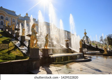 Petergof, Russia - May 05, 2016: view of The Grand Cascade, the largest fountain ensemble in Peterhof, sunny spring day. Samson fountain sculptor B.C. Rastrelli. jets of water lit by the sun