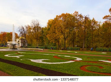 PETERGOF, RUSSIA - OCTOBER 13, 2018: Autumn park with fountain and golden trees