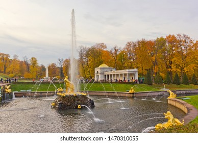Petergof, Russia - October 13, 2018: Autumn park with Samson Fountain with golden figures