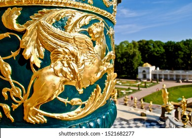 Petergof, Saint Petersburg, Russia - 2014: A gold gryphon on an emerald green vase above the Grand Cascade and Samson Fountain at the Peterhof Palace.