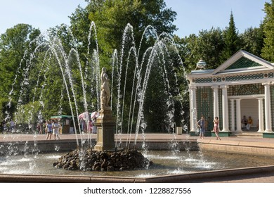 "Petergof, St. Petersburg, Russia - August 09, 2018: Fountain ""Eve"" by Venetian sculptor Giovanni Bonazza in the alley of the park in Petergof, St. Petersburg"