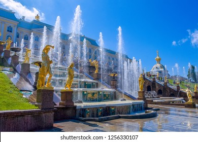 Petergof, St Petersburg, Russia - JULY 1, 2012: View from Grand Petergof Palace to Lower park with fountains, golden statues and channel.