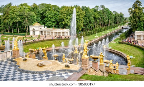 Petergof, St Petersburg, Russia - September 1, 2012: View from Grand Petergof Palace to Lower park with fountains, golden statues and channel. Unidentified tourists present on picture.