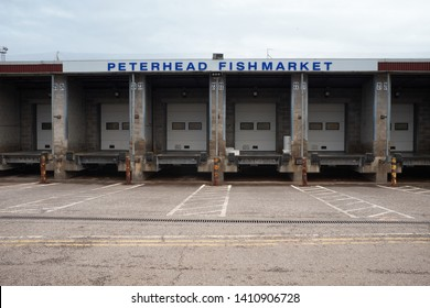 PETERHEAD, ABERDEENSHIRE, SCOTLAND, UK. 7th July 2017. Mid afternoon, and the loading bays at the Peterhead Fishmarket wait for the fishing fleet to arrive
