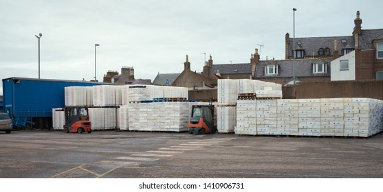 PETERHEAD, ABERDEENSHIRE, SCOTLAND, UK. 7th July 2017. Stacks of empty fish crates wait to be filled at Peterhead fish market