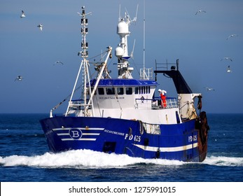 Peterhead, Scotland, 23rd June 2016. Fishing vessel underway at speed to disharge fish at market.