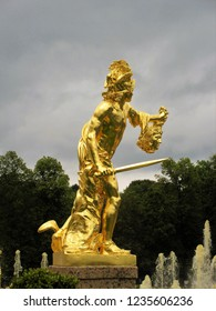 Peterhof Palace, Saint Petersburg, Russia / August 14th 2016 / Bronze gilded statue of Perseus with the head of Medusa, Grand Cascade Fountain