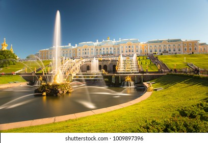 PETERHOF, RUSSIA,  Grand cascade in Pertergof, St-Petersburg. the largest fountain ensembles. Wide angle lens and long exposition. Summer blue sky.
