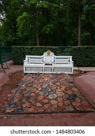 "PETERHOF, RUSSIA - JULY 01, 2014: Fountain-cracker ""Bench"" in Monplaisir garden in lower park of Peterhof, Saint Petersburg, Russia"