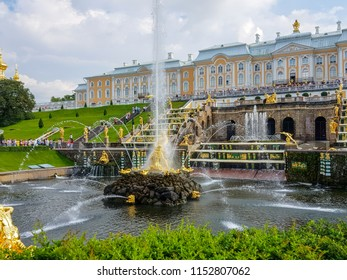 """Peterhof, Russia, July 26, 2018: The 20 m high vertical jet of water from the lion's mouth of the Samson Fountain. The Peterhof Palace sometimes referred as the """"Russian Versailles""""."""