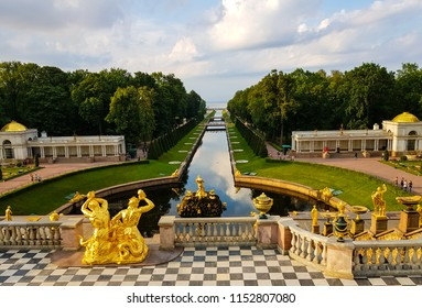 "Peterhof, Russia, July 26, 2018: The Samson Fountain and Sea Channel. The Peterhof Palace is a series of palaces and gardens, sometimes referred as the ""Russian Versailles""."