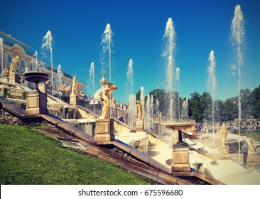 PETERHOF, RUSSIA - JUNE 16, 2017: The Grand Cascade, the most famous ensemble of fountains in the park, comprises 64 different fountains and over 200 bronze statues. Instagram effect.
