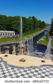PETERHOF, RUSSIA - JUNE 16, 2017: The Grand Cascade, the most famous ensemble of fountains in the park, runs from the northern facade of the Grand Palace to the Marine Canal