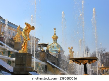 Peterhof, Russia - May 1, 2019: Grand cascade in Petergof, Saint Petersburg city suburb. Fountain ensembles with 60 water fountains and gilded sculptures