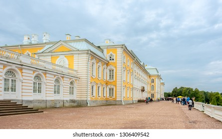 PETERHOF, RUSSIA - SEPTEMBER 1 : Entrance buildings of Grand palace of Peterhof under cloudy sky in Russia, on September 1, 2018.