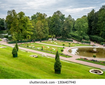 PETERHOF, RUSSIA - SEPTEMBER 1 : Fountains in famous garden around Grand cascade palace of Peterhof in summer season under cloudy sky in Russia, on September 1, 2018.