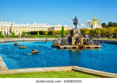 PETERHOF, RUSSIA - SEPTEMBER 23, 2017: Petergof or Peterhof, known as Petrodvorets from 1944 to 1997 and Neptune Fountain. The Peterhof Palace included in the UNESCO's World Heritage List.