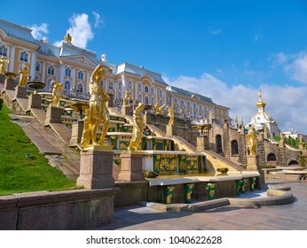 Peterhof, Saint Petersburg, Russia - August 3, 2017: Beautiful golden sculptures in Grand Cascade Fountain in Peterhof