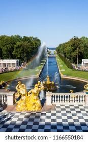 PETERHOF, SAINT PETERSBURG, RUSSIA - August 24, 2018: A view from the Peterhof Palace on the Bolshoy Samsonovskiy Canal, the Samson Fountain and gilt sculptures of Tritons