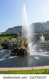 PETERHOF, SAINT PETERSBURG, RUSSIA - August 24, 2018: The famous fountain with sculpture Samson Tearing Apart  Jaws of Lion in center of the Grand Cascade against the backdrop of Peterhof Palace