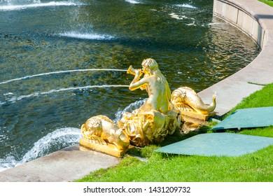 Peterhof, SAINT PETERSBURG, RUSSIA - JUNE 06, 2019: Grand Cascade in Petergof, golden statue of a girl
