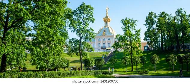 Peterhof, SAINT PETERSBURG, RUSSIA- JUNE 06, 2019: panoramic scenic view on  Grand Palace in Petergof, St Petersburg