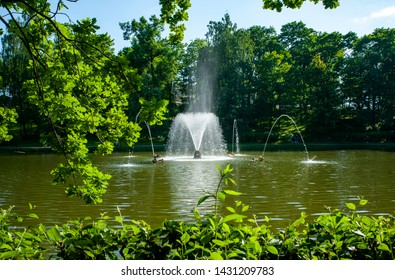 Peterhof, SAINT PETERSBURG, RUSSIA - JUNE 06, 2019:  Fountains in Petergof, Beautiful veiw  on the fountain in the lake in plant vignette