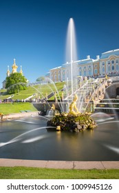 PETERHOF, Saint-Petersburg, RUSSIA,  Grand cascade in Pertergof, St-Petersburg. the largest fountain ensembles.Wide angle lens and long exposition.Summer blue sky.