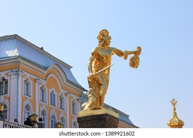 Peterhof's Grand Cascade fountains Golden statue of Perseus with the Head of Medusa in St. Petersburg, Russia on May 1, 2019