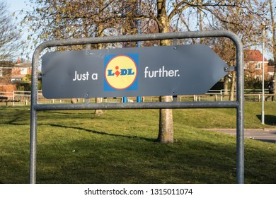 Peterlee / Great Britain - February 15, 2019: Just a Lidl Further car park sign for Lidl supermarket with grass and urban setting in background.