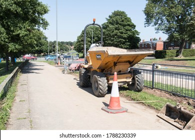 Peterlee / Great Britain - July 31, 2020 : Small dumper truck parked at the side of sidewalk pavement in street
