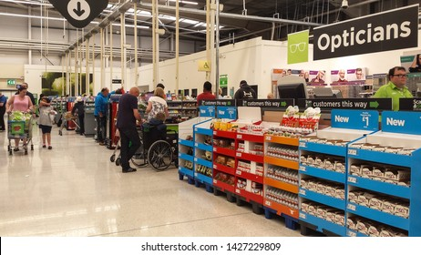 Peterlee / Great Britain - May 23, 2019 : Checkout area is lareg modern Asda supermarket showing checkouts and customers