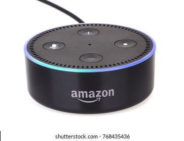 PETERSBURG, ILLINOIS/USA-DECEMBER 1, 2017: Amazon echo dot a handsfree voice controlled device that connects to the Alexa voice service isolated on white