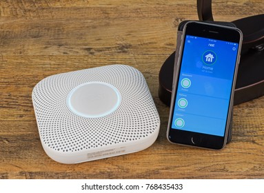 PETERSBURG, ILLINOIS/USA-NOVEMBER 30, 2017: Nest Protect smoke and carbon monoxide alarm and its smartphone app