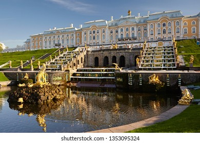 Petersburg, Russia - May 2018:  Fountains in Peterhof and a baroque palace against a blue sky. Architecture and attractions