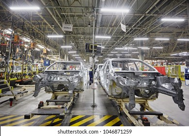 Petersburg, Russia - November 2017: The bodies of cars on the assembly line go on the conveyor at the car factory. Modern production. On the shelves are the steel parts