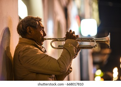 Petersburg, Russia, October 1, 2016: Man playing a music on a trumpet in Petersurg, Russia.
