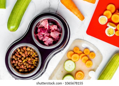 petfood set with vegetables and meat on kitchen table background