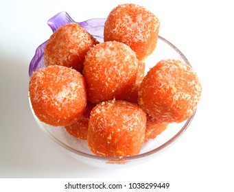 Petha is world famous sweet of Agra, India. Traditionally it is made from Ash Gourd and  dipped in sucrose. To bring variety and attract new buyers little variations are made like adding rose flavor