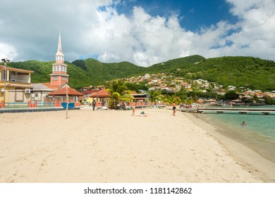 Petite Anse d'Arlet, Martinique, France - 20 July 2017: Petite Anse d'Arlet village, with Saint Henri Church and pontoon.