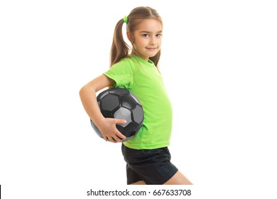 Petite athletic girl with giant holding a ball