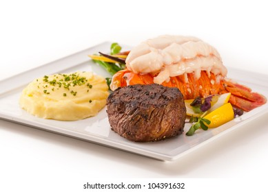 Petite Fillet and Lobster, focus on meat, on white