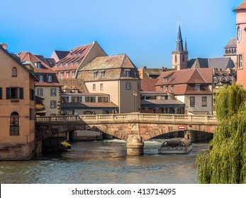 Petite France in Strasbourg, Alsace. Traditional old town architecture. River canal, bridge, houses. European historic travel, tourism. Famous medieval historic landmark street. Colorful french city.
