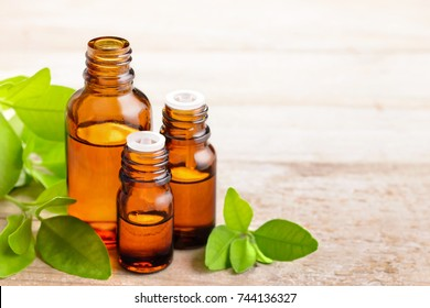 Petitgrain essential oil in the amber bottle