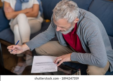 Petition for divorce. An elderly man filling a petition for divorce