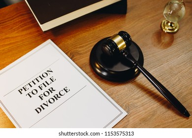 Petition to file for divorce legal documents with gavel at the side