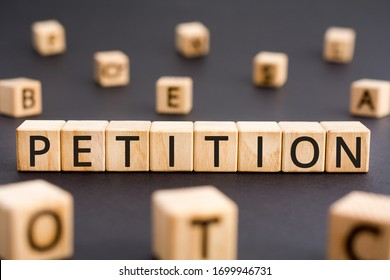 Petition - word from wooden blocks with letters, a formal request petition concept, random letters around black background